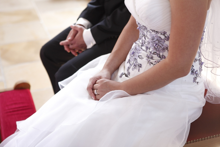 Hands Of A Bride And Groom