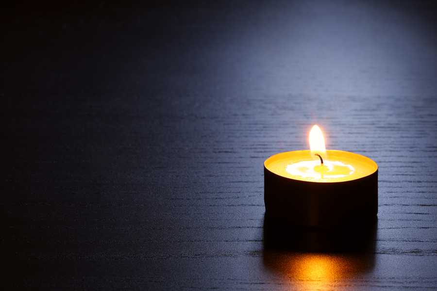 Single Candle With Back Lit. Tranquil Scene