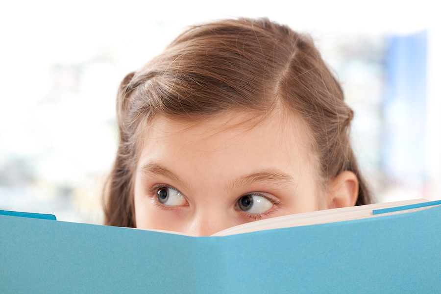 Girl Reading A Book At School